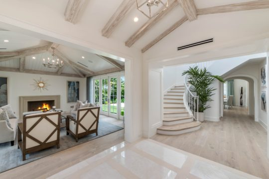 Arabian living room and staircase by Ecclestone Homes