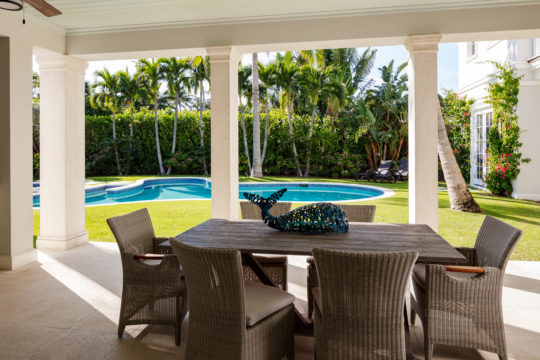 Palmo outdoor dining set and pool area by Ecclestone Signature Homes