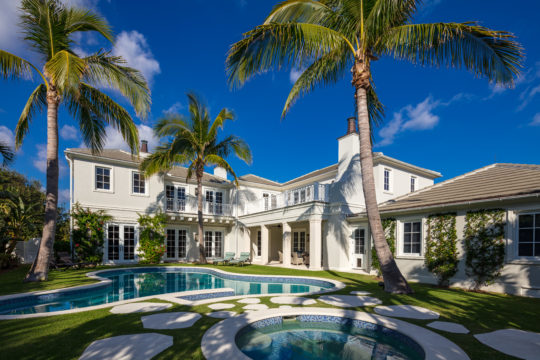 Backyard pool and exterior of Palmo by Ecclestone homes