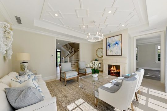 living room with fireplace remodeled by llwyd ecclestone