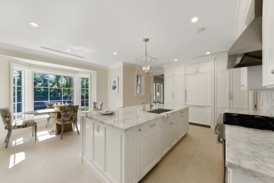 Bright with kitchen with large island by llywd ecclestone homes