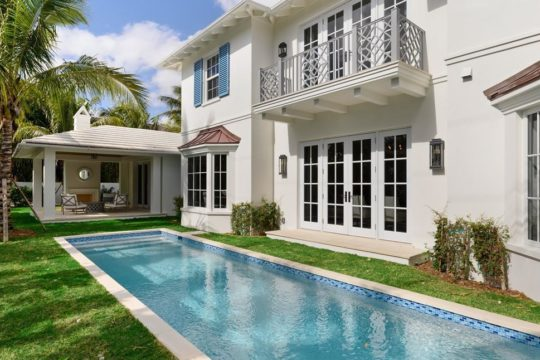 lap pool along the side of bahama home by ecclestone