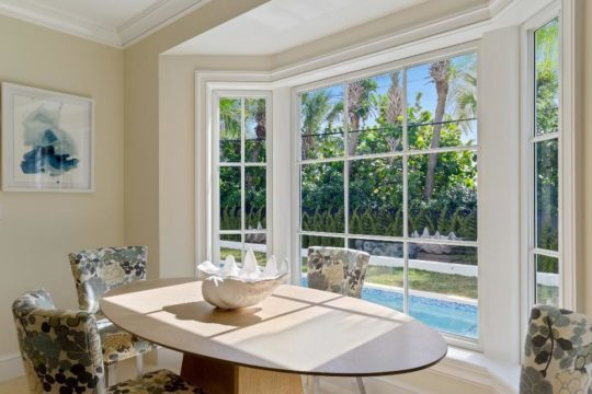 breakfast nook with view of the lap pool by llwyd ecclestone