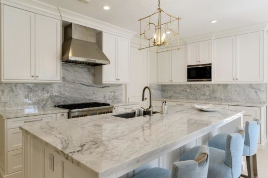 clean modern designed kitchen with stone countertops by Ecclestone Signature Homes
