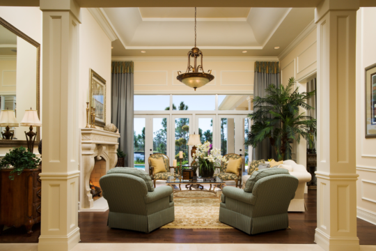 Medalist living room with large furniture before ecclestone