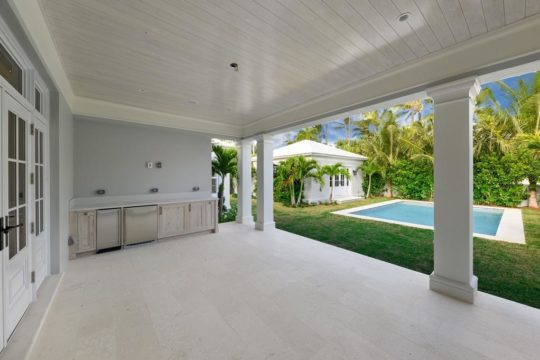 outdoor kitchen and pool by llwyd ecclestone