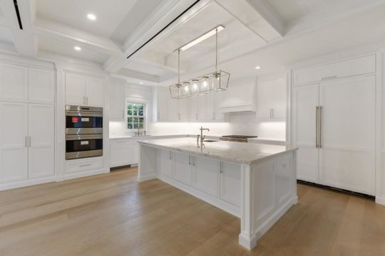large white kitchen renovated by llwyd ecclestone