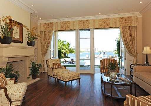 Old Harbour Living room with fireplace and view of water