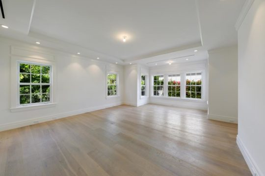 bahamas large living area with wood floors by ecclestone homes