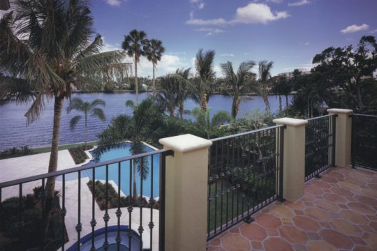 Villa Providencia Balcony overlooking the pool and the water in Palm Beach