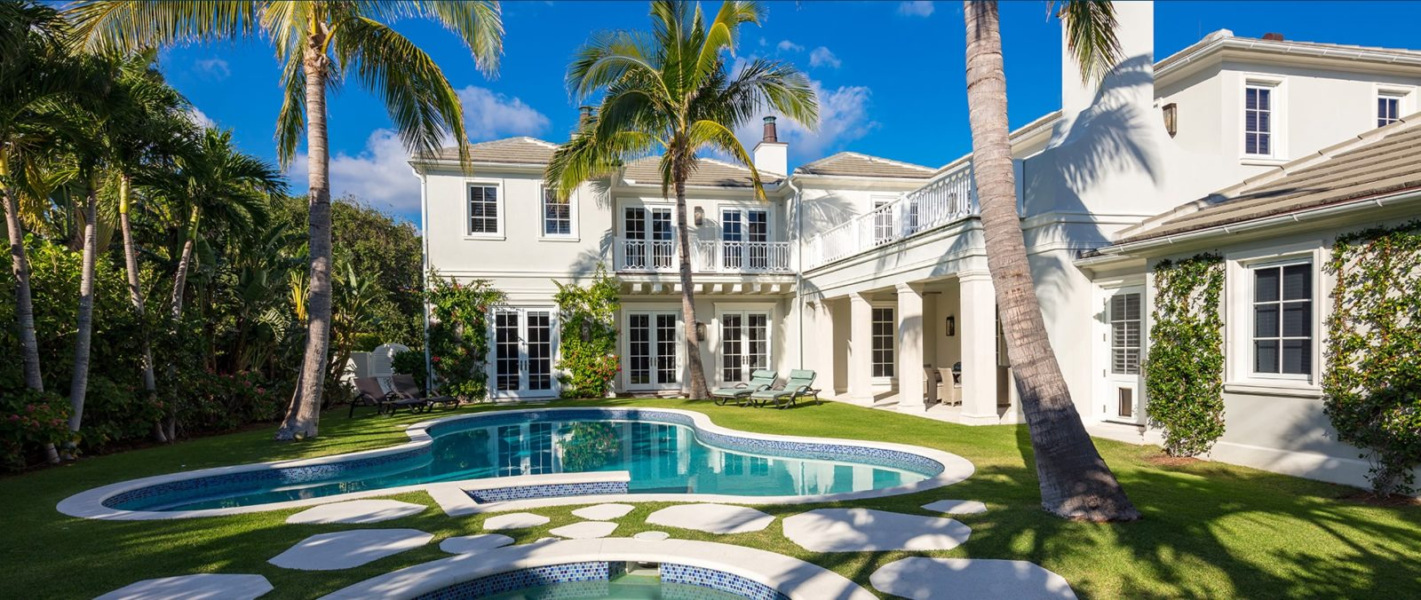 large two story home with pool by ecclestone home