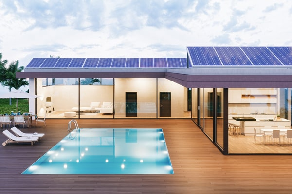 home with solar panels, glass walls and pool