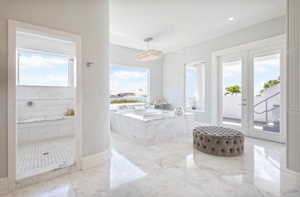 expansive marble master bathroom